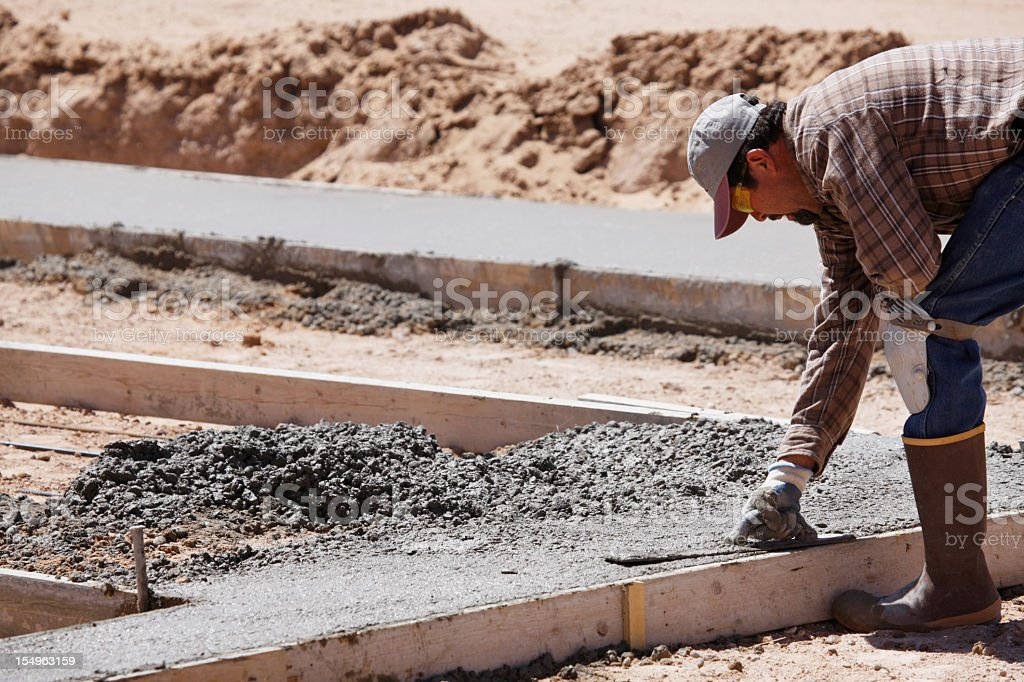 Cement Worker Working on Foundation royalty-free stock photo