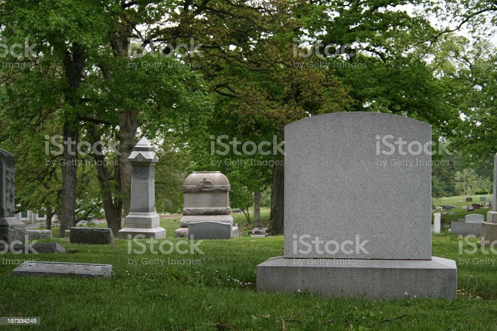 A cemetery and tombstone in the daylight stock photo
