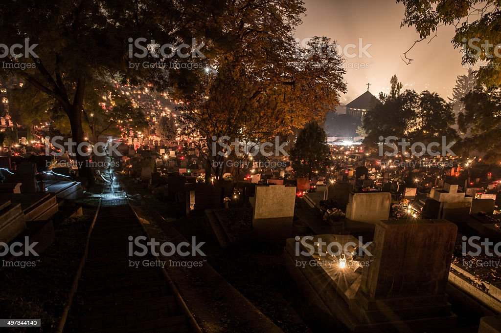 cemetery at night in candlelight stock photo