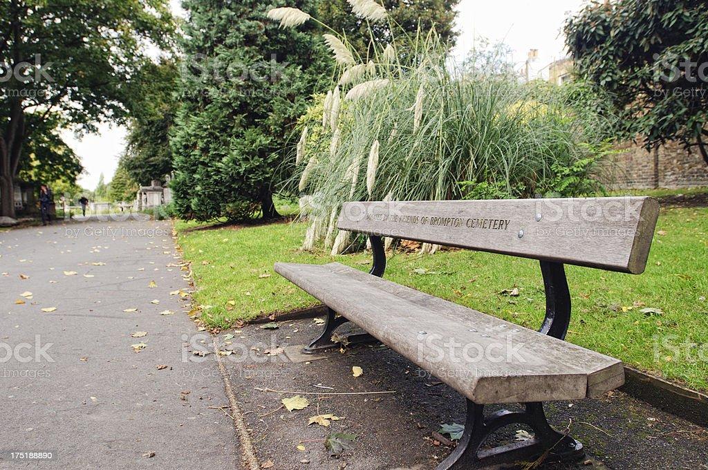 Cemetery bench stock photo