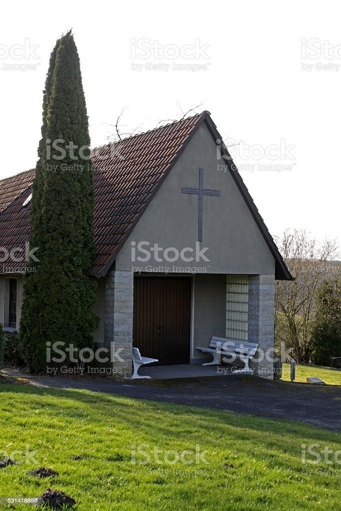 Cemetery chapel in Bremke stock photo