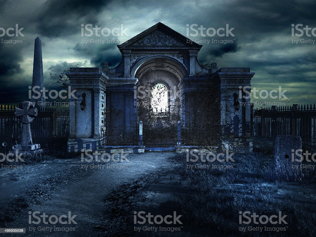 Cemetery crypt at night stock photo