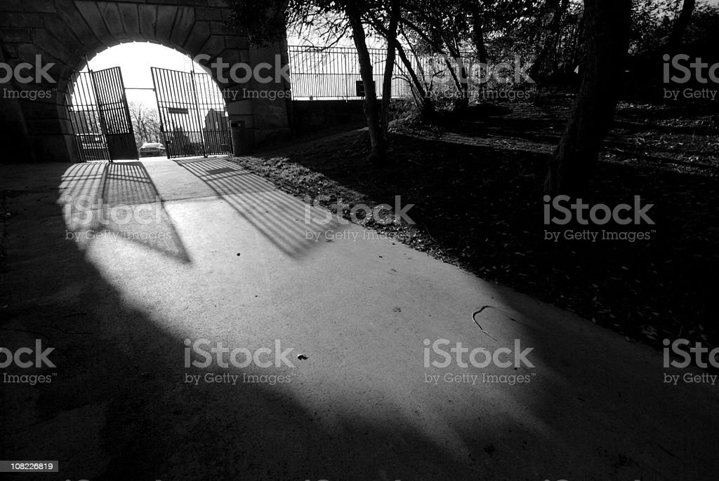 Cemetery gates black and white royalty-free stock photo