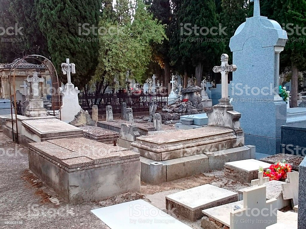 Cemetery, graves and tombstones in an autumn morning stock photo