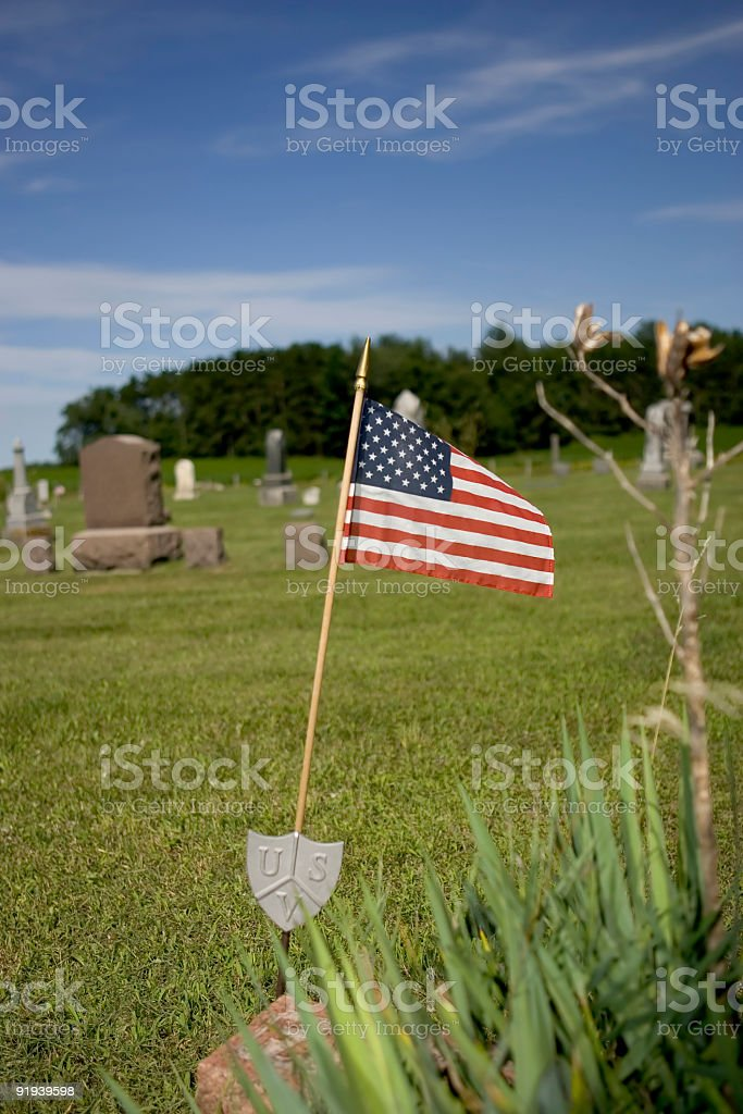 Cemetery in the country with American Flag royalty-free stock photo
