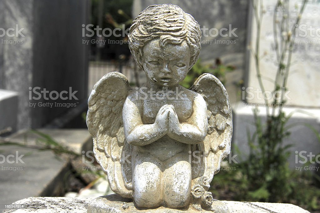 Cemetery Statue of a Child in Praying Position royalty-free stock photo