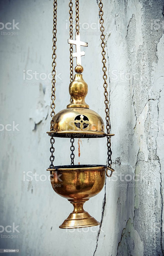 censer chain weighs nearly a white wall stock photo