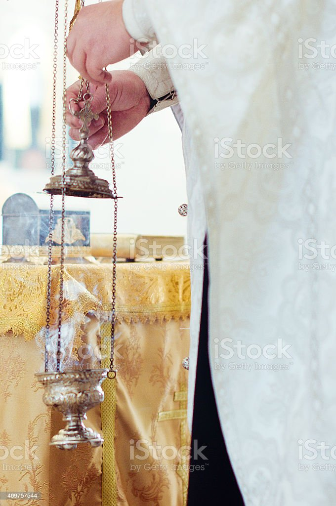 Censer in hands of the priest stock photo