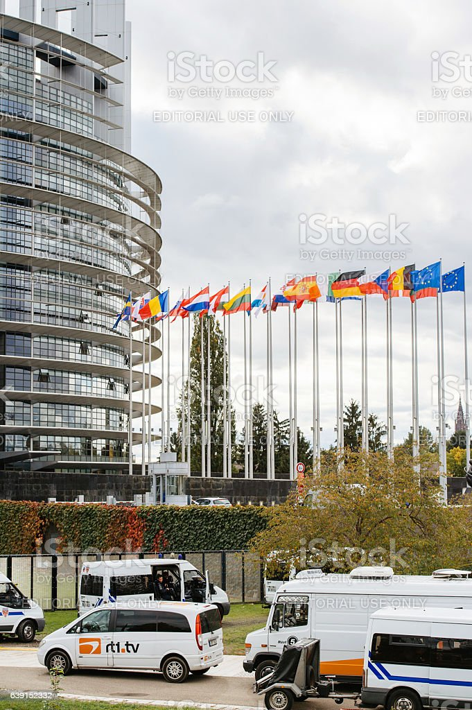 Censure police officers surveilling tv trucks at European Parliament stock photo