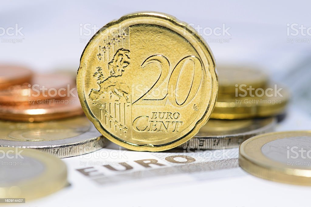 20 cent euro coin with euro coins and bills in background stock photo