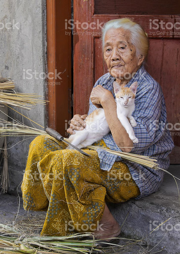Centenarian Lady Holding Cat stock photo