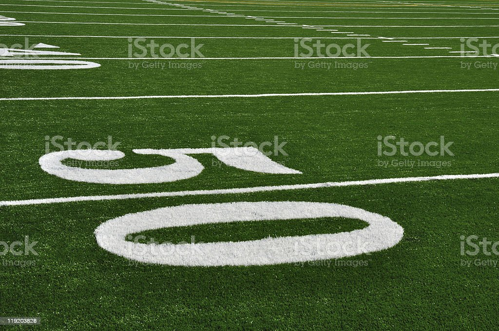 Center of fifty yard line on football field stock photo
