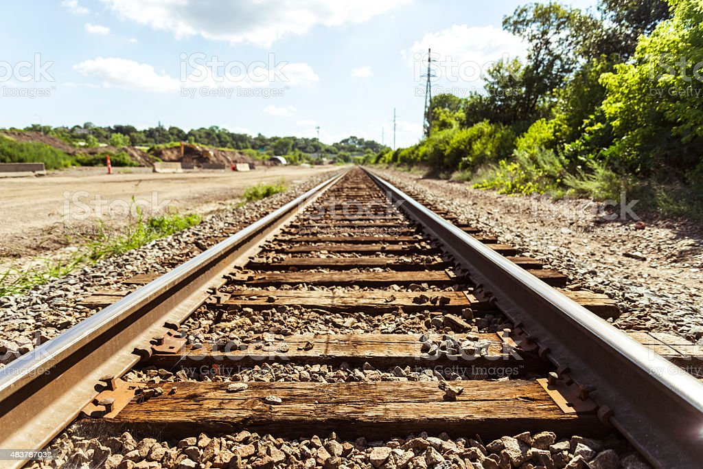 Center of Railway Traintracks Close to Ground - Diminishing Perspective stock photo