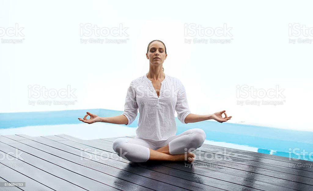 Centered within the lotus pose stock photo