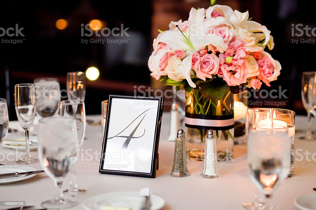 Centerpieces on a table at wedding reception stock photo
