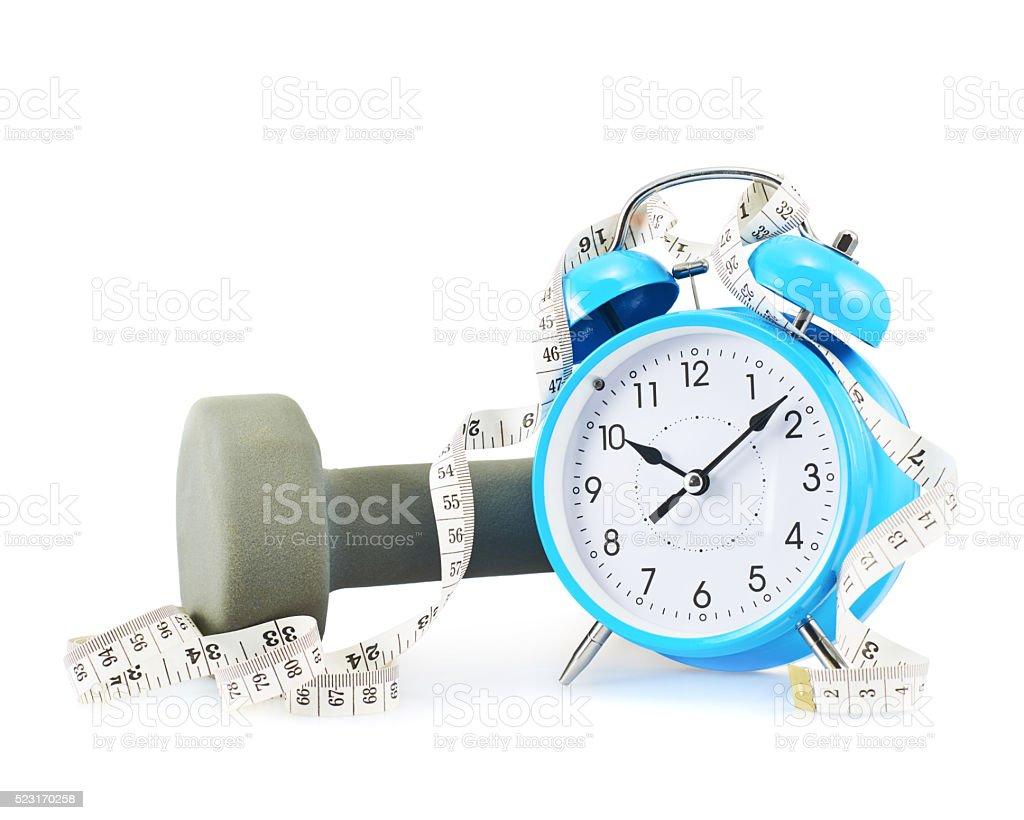 Centimeter tape, clock and dumbbell stock photo