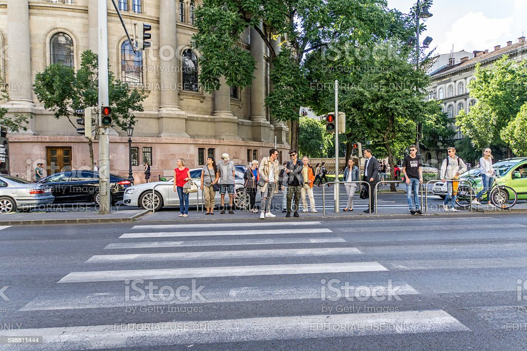 Central Budapest street people waiting to cross road stock photo