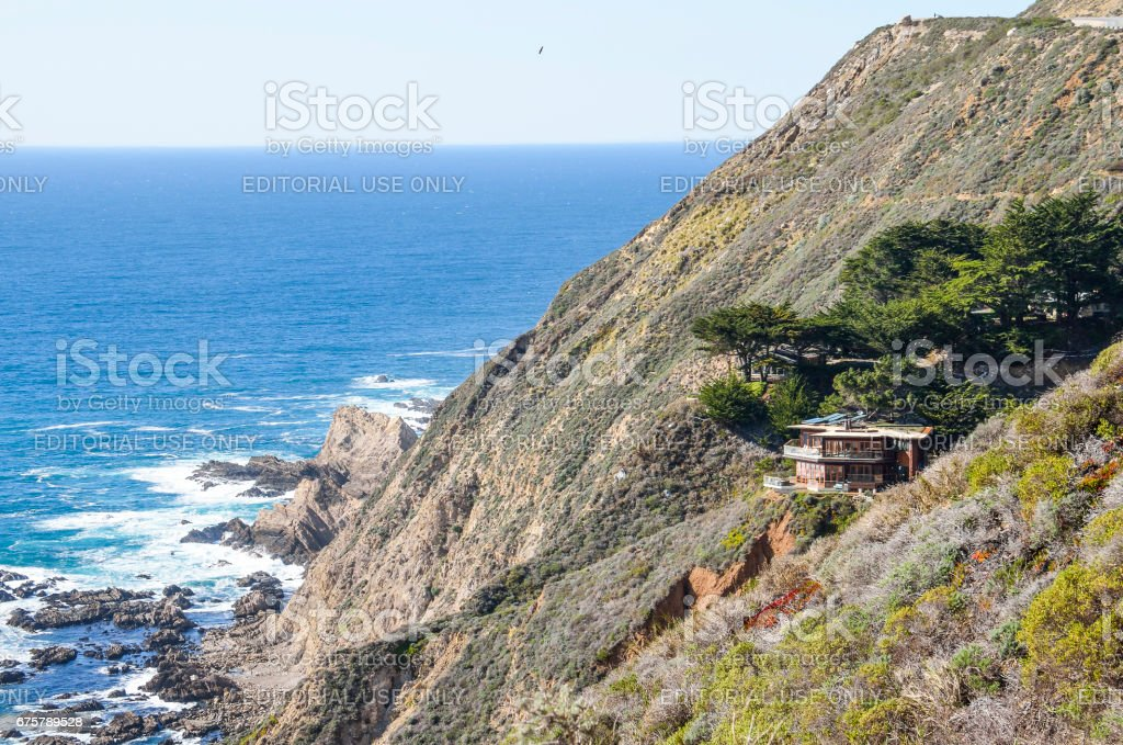 Central California coast with cliffs and blue ocean with house on cliff stock photo