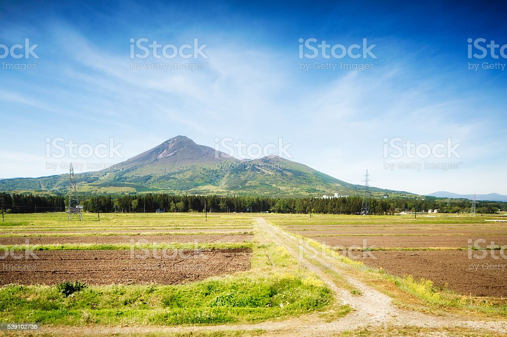 Central Honshu Japan landscape with mountains road and rice paddies stock photo
