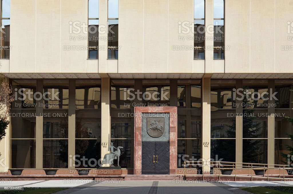 VILNIUS, LITHUANIA - MARCH 27, 2016: Central metal door of an entrance to  ' Seimas' (parliament)  of the republic Lithuania. Parliamentarians have a rest. Solar quiet Easter morning stock photo