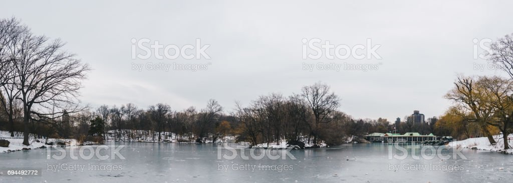 Central Park Boathouse and iced lake in New York City, USA. Panoramic view. stock photo