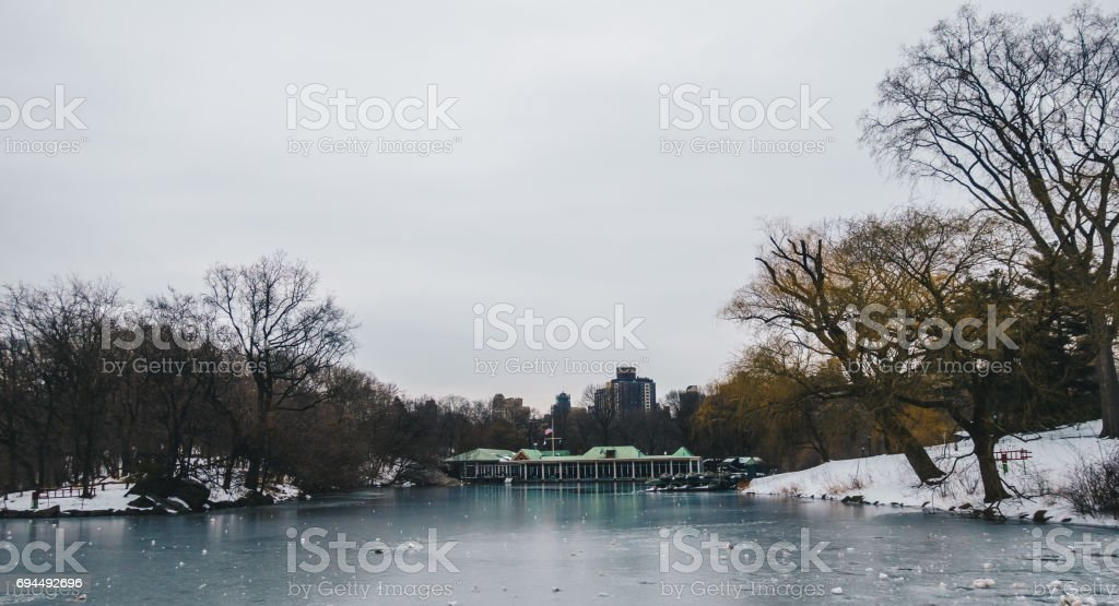 Central Park Boathouse and iced lake in New York City, USA stock photo