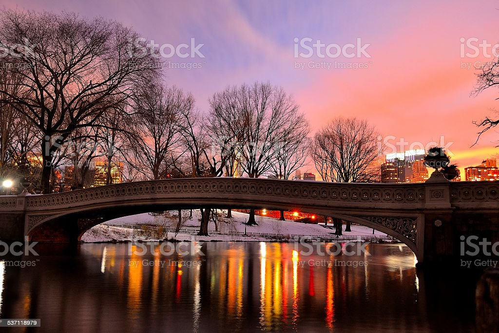 Central Park Bow Bridge on Snowy Colorful Sunset stock photo