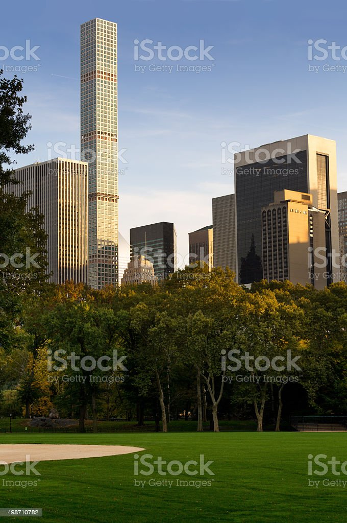 Central Park, Foliage Colors and New York Skyline at Sunset. stock photo