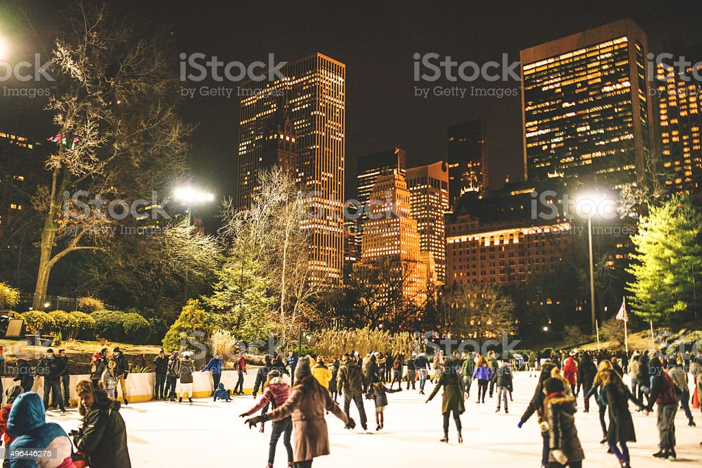 Central Park ice rink people having fun stock photo