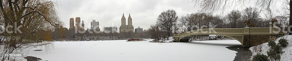 Central Park panorama with Bow Bridge in winter royalty-free stock photo