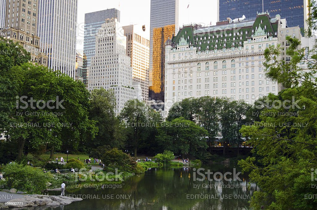 Central Park pond and Plaza Hotel in New York City stock photo