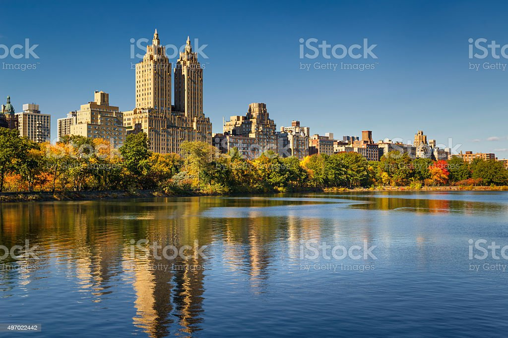 Central Park Reservoir, fall foliage and Upper West Side. Manhattan stock photo