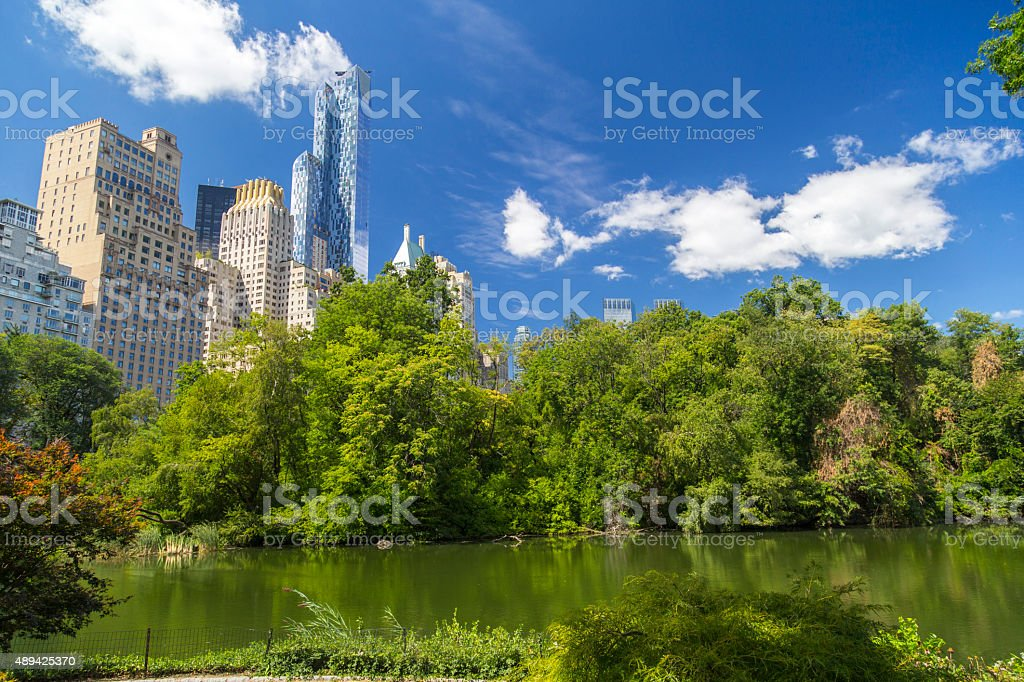 Central Park South skyline from Central Park Lake in NYC stock photo