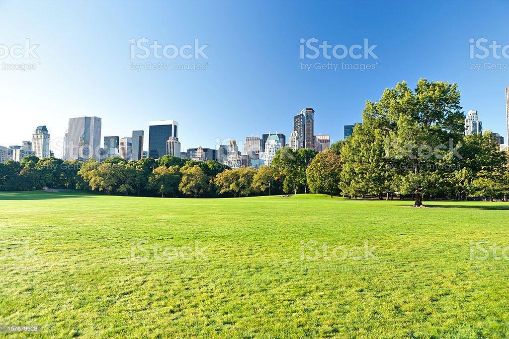 Central Park with Manhattan skyscrapers behind stock photo