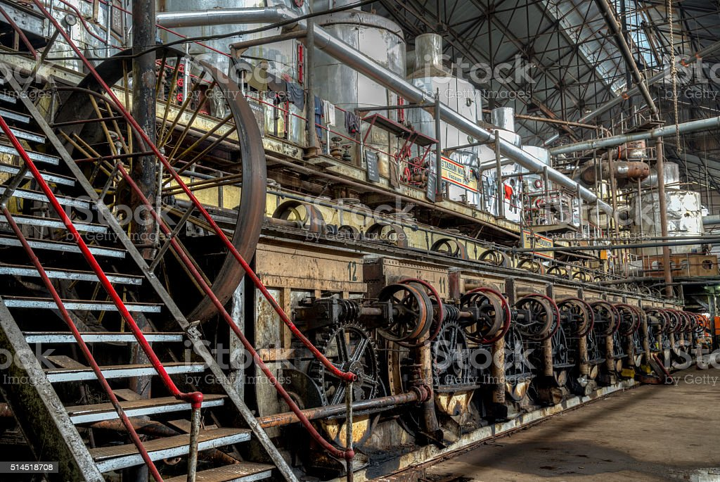 Central shaft driving by belt other machines in old  factory stock photo