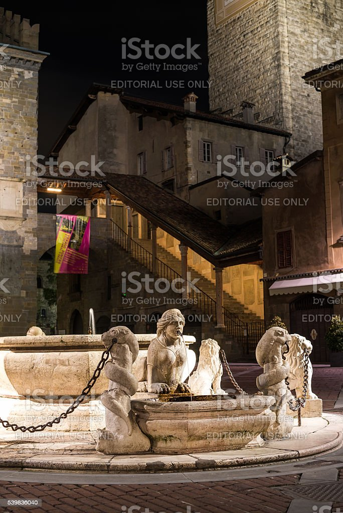 Central square of medieval town with fontaine stock photo