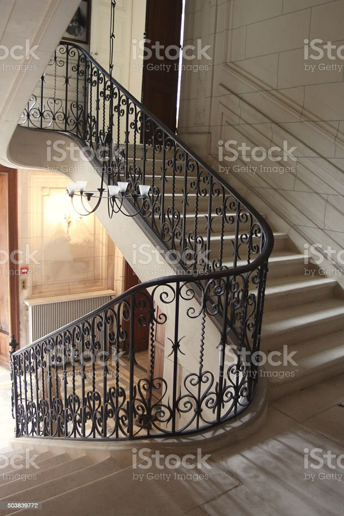 Central Staircase Inside A French Chateau stock photo