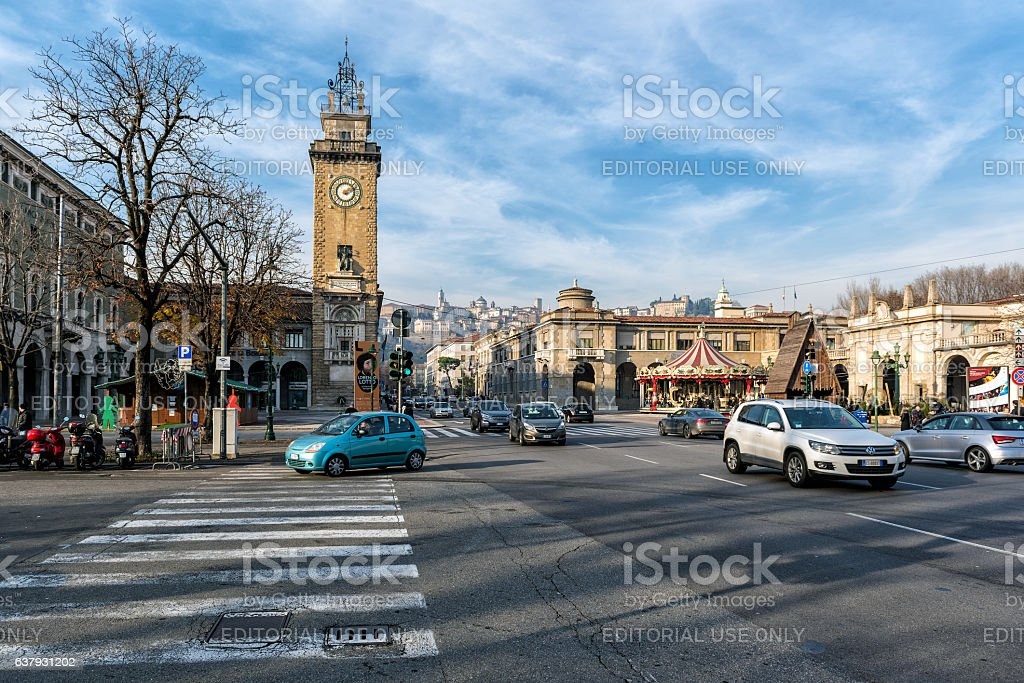Central street full of transport in Bergamo town, Italy stock photo