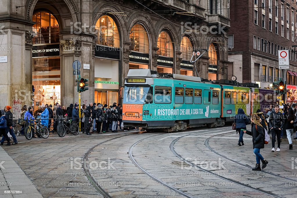 Central street of Milan with many people near tram station stock photo