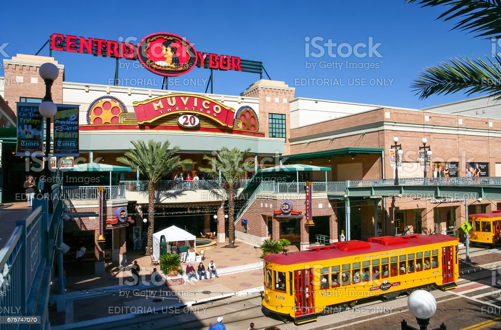 Centro Ybor entrance with yellow trams and visiting tourists stock photo