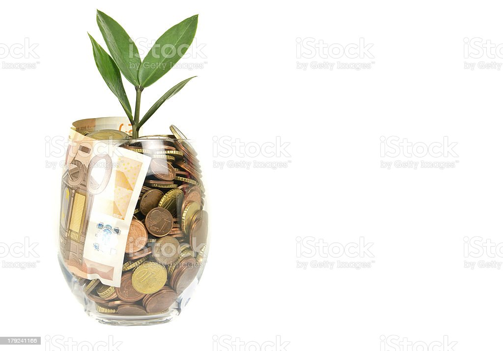 Cents and banknotes in glass royalty-free stock photo