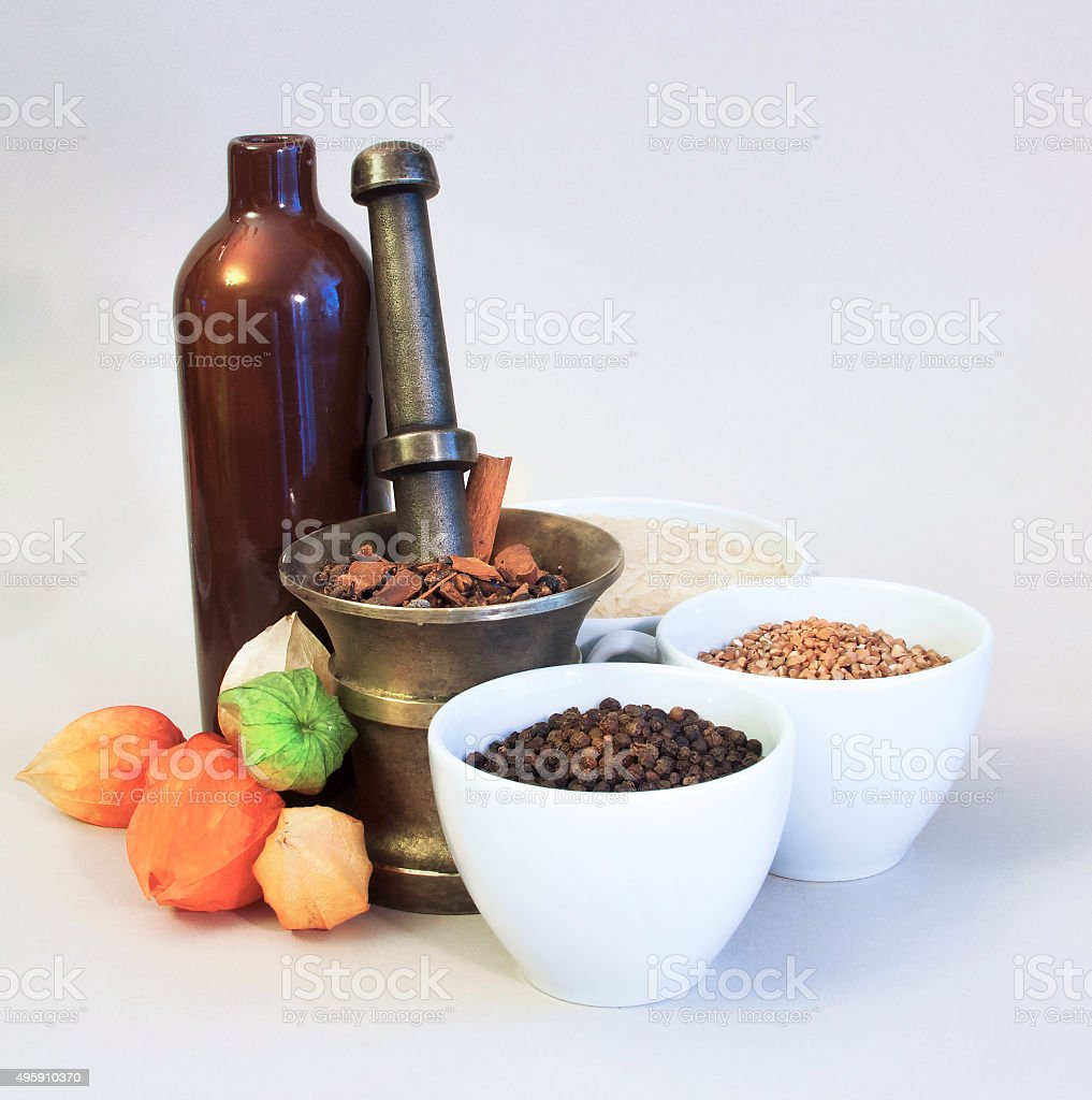 ceramic and brass vessels with cereals, spicery and fruits stock photo
