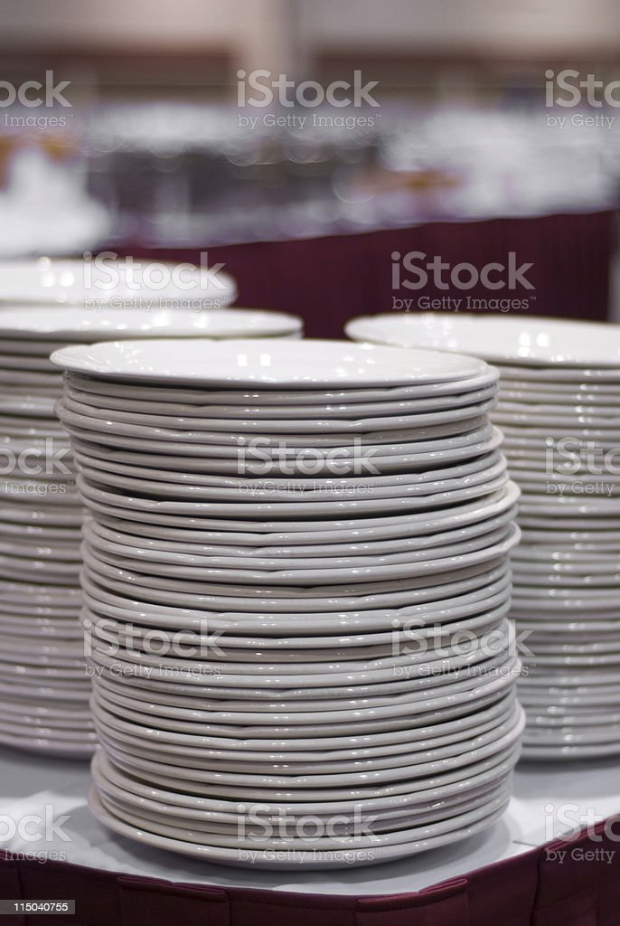 Ceramic Beige Dinner Plates Stacked on a Banquet Table royalty-free stock photo