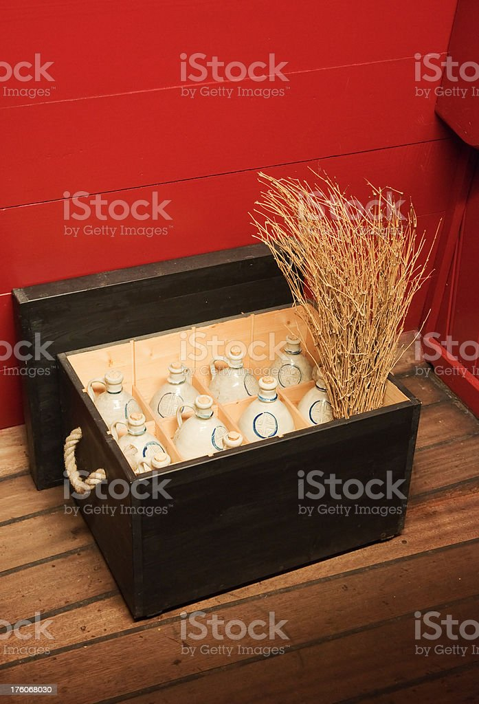 Ceramic bottles in wooden box royalty-free stock photo