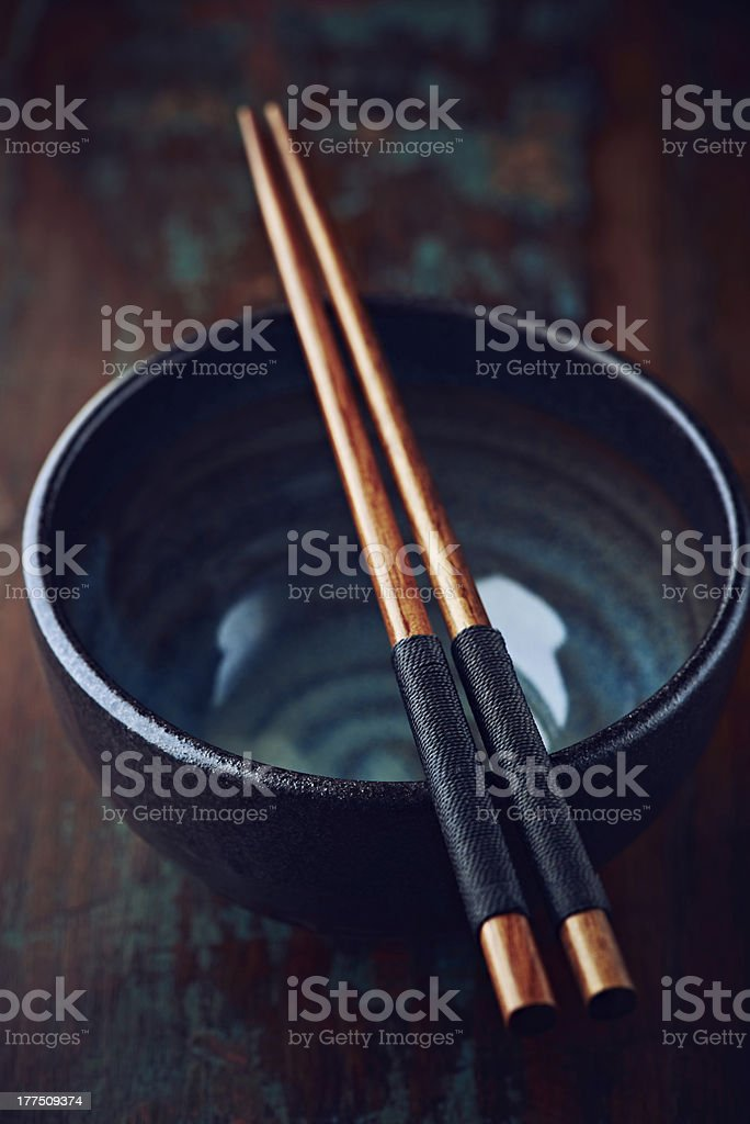 Ceramic bowl and chopsticks royalty-free stock photo