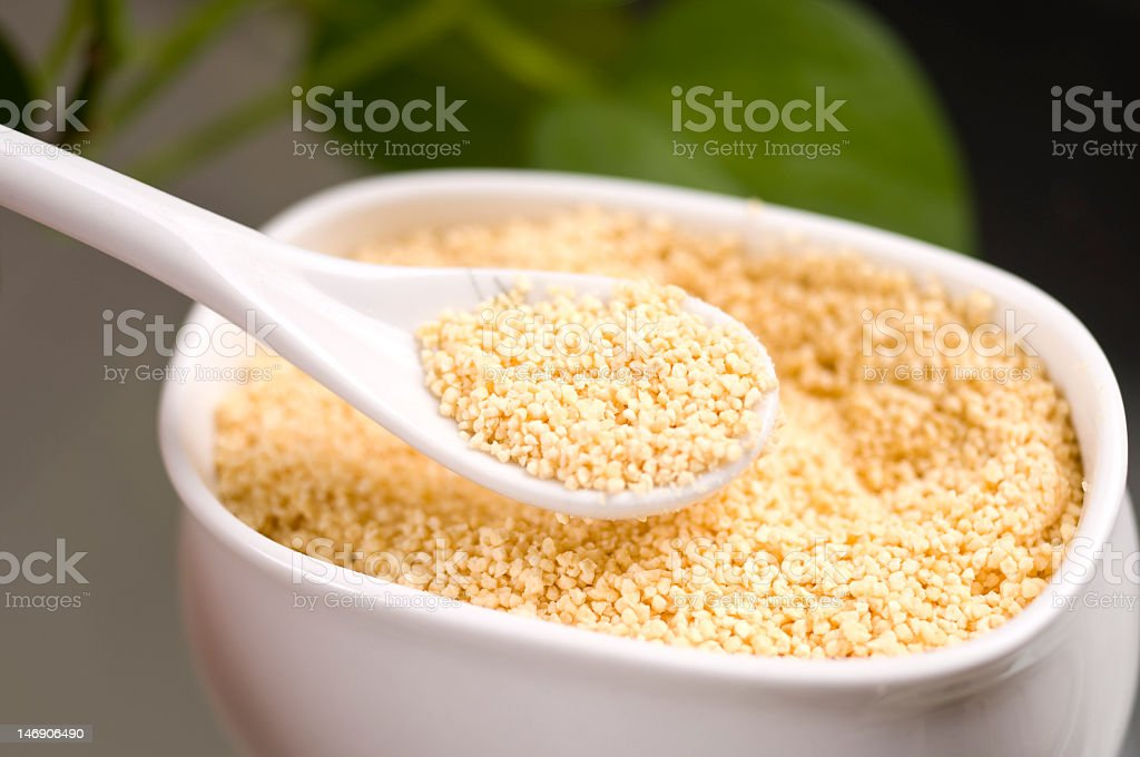 A ceramic bowl and spoon filled with Lecithin granules stock photo