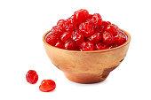 Ceramic bowl of dried cherries on white