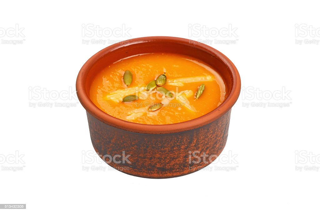 Ceramic bowl of pumpkin soup over white royalty-free stock photo