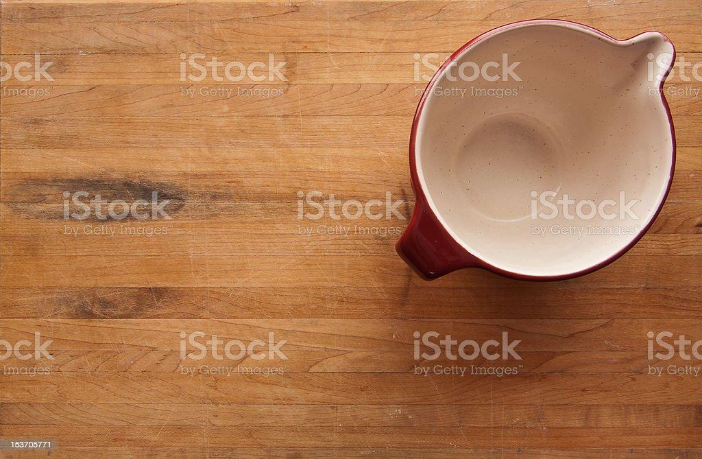 Ceramic Bowl on Butcher Block Counter royalty-free stock photo