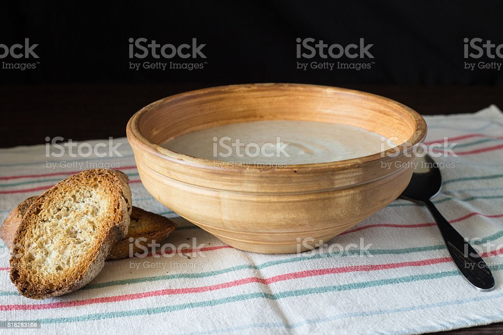 Ceramic bowl with mushroom soup puree with bread stock photo